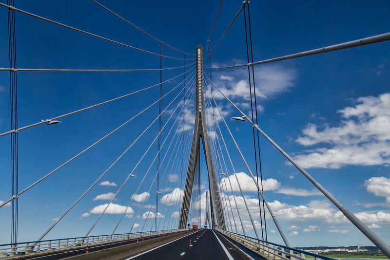 Just outside Honfleur, France is the incredible Normandy Bridge. You don't expect this type of contemporary design in the middle of the French countryside. Photo by Tim Stanley Photography.