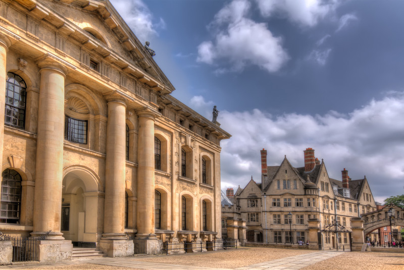 The Clarendon Building (on the left) is a landmark building in Oxford, England, owned by the University of Oxford. Built between 1711 and 1715 , it stands in the center of the city in Broad Street, near the Bodleian Library and the Sheldonian Theatre. Photo by Tim Stanley Photography.