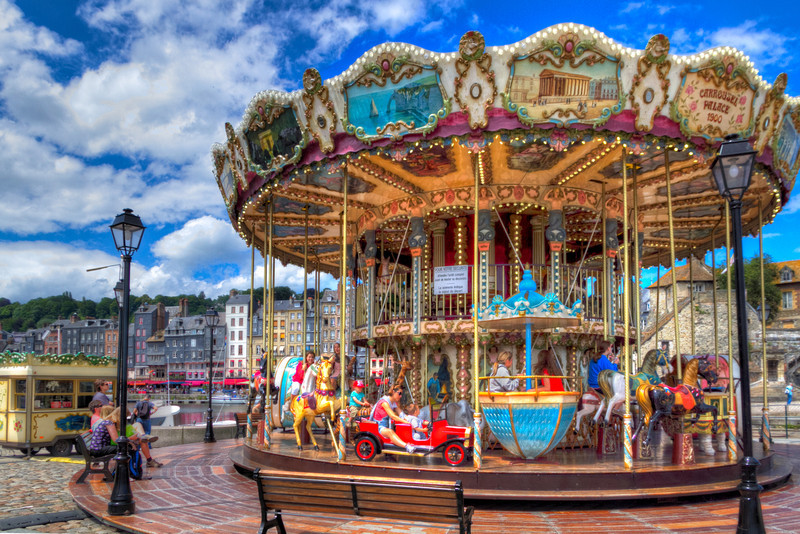 By the entrance to the little marina in Honfleur, France is this beautiful, double decker carousel. I haven't found much information online about it, other than it's open during the tourist season and possibly built around 1900.