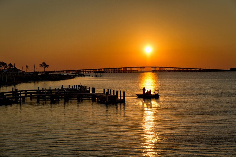 These fishermen are pulling out from Shoreline Park in Pensacola, with the Pensacola Beach Bridge in the background. Photo by Tim Stanley Photography.