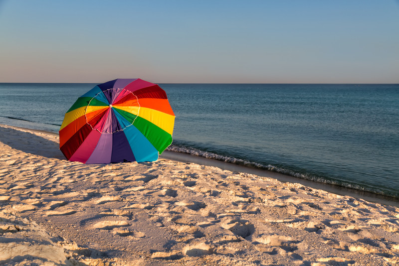 Walking along Pensacola Beach, I saw this lonely beach umbrella waiting for someone to come visit. Fortunately, the wind wasn't heavy or it might have taken a trip of its own down the shore. Photo by Tim Stanley Photography.