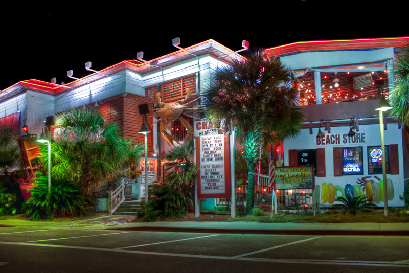 'Crabs' is a popular seafood restaurant on Pensacola Beach, Florida, in the shadow of  their water tower painted like a big beach ball. Photo by Tim Stanley Photography.