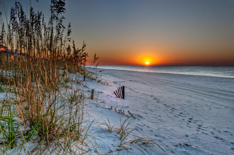 Nothing starts the week out like a beautiful sunrise, unless of course you're on vacation at the beach or other favorite get-away. Like most folks, I'm at work this week, but looking back on memories like this help brighten up the time, until once again, I get to experience it first hand. Photo by Tim Stanley Photography.