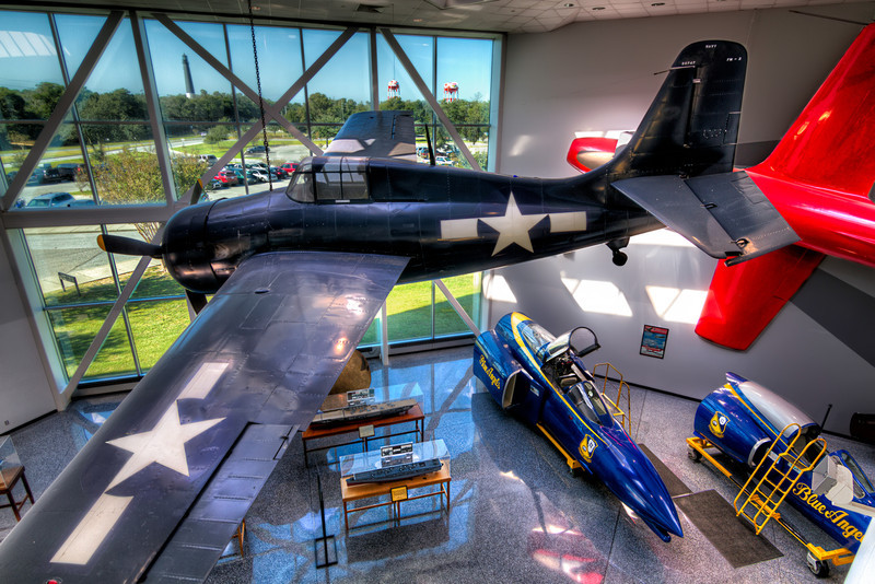 This Wildcat hangs in the Quarterdeck st the National Naval Aviation Museum beside the F9F-2 Panther. This shot is perfect for HDR photography, because it allows you to balance the indoor and outdoor exposures. Photo by Tim Stanley Photography.