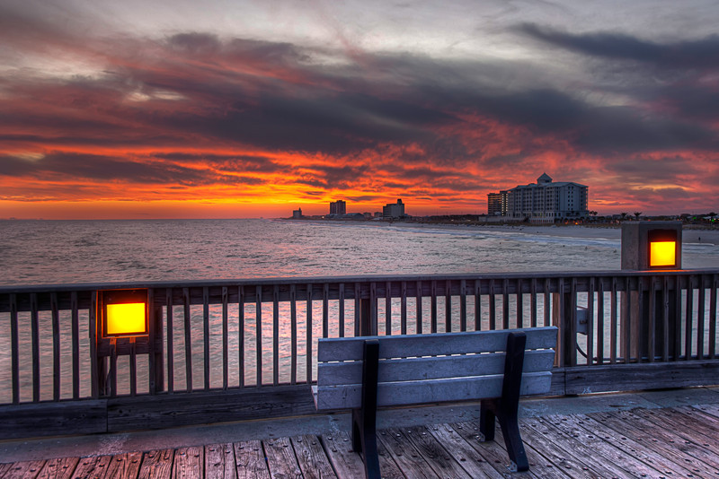 The Pensacola Beach Fishing Pier is a great place to view the sunset or sunrise. Go out past the surf, where it's quiet and a great place to reflect on things.  Photo by Tim Stanley Photography.