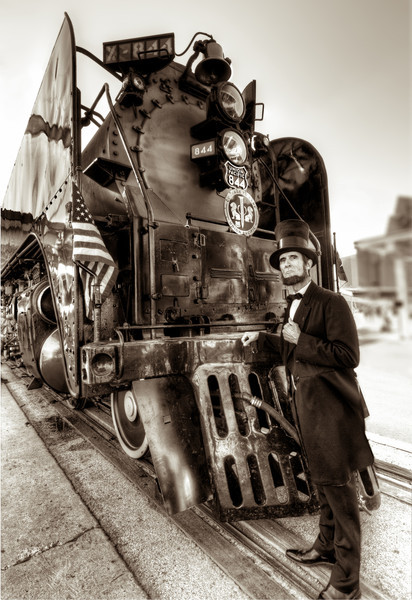 This massive steam engine and it's train were at the Amtrack station in downtown Houston this past Saturday, part of the Union Pacific's 150th celebration. I saw President Lincoln there and he was only too happy to pose for a photo for me. He and the engine are both looking pretty good for their age. Photo by Tim Stanley Photography.