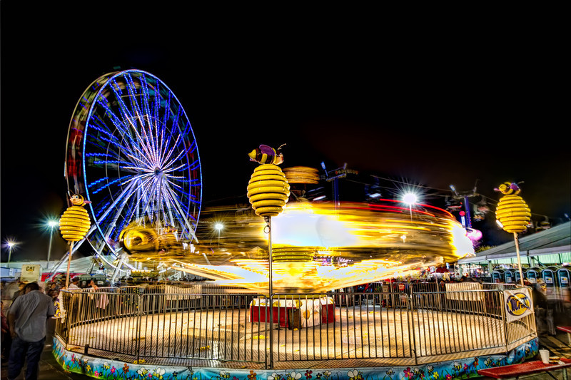 If you have ever want to try you luck at night time photography, make your way to the nearest carnival. The lights, movement and rides guarantee you will walk away with something that will surprise and please you. Don't forget your tripod though, since you want the stationary objects to look stationary. Photo by Tim Stanley Photography.