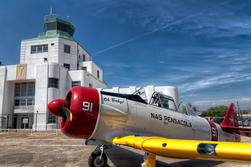 A while back I gave you a taste of this T-6 Texan, but I thought you deserved to see the entire plane. It's just that nice. This was at the monthly fly-in at the 1940 Air Terminal Museum. Photo by Tim Stanley Photography.