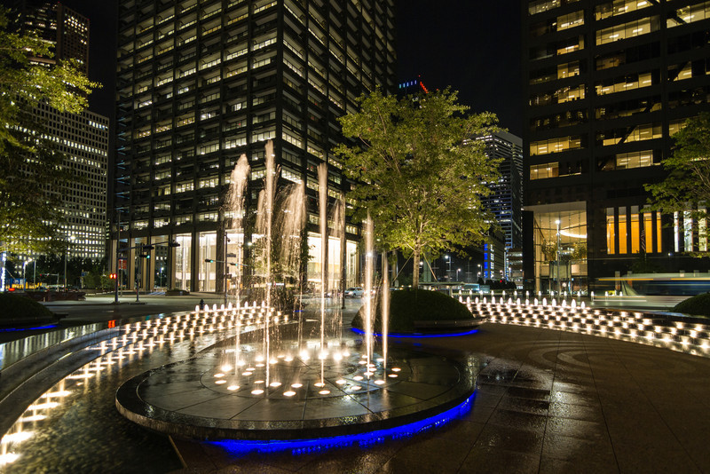 At the entrance to Enterprise Plaza in downtown Houston is a dancing fountain that should be seen at night to enjoy. Photo by Tim Stanley Photography.