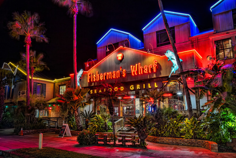 The Fisherman's Wharf in Galveston, TX offers you a great seafood dinner on the back patio while enjoying a view of the sailing ship Elissa. Photo by Tim Stanley Photography.