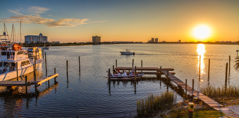After a day on the water, it's both a relief and let down to return to the pier. The fun is over, but the memories will last long past the day. This was taken at Shaggy's on Santa Rosa Island in Pensacola, Florida. Photo by Tim Stanley Photography.