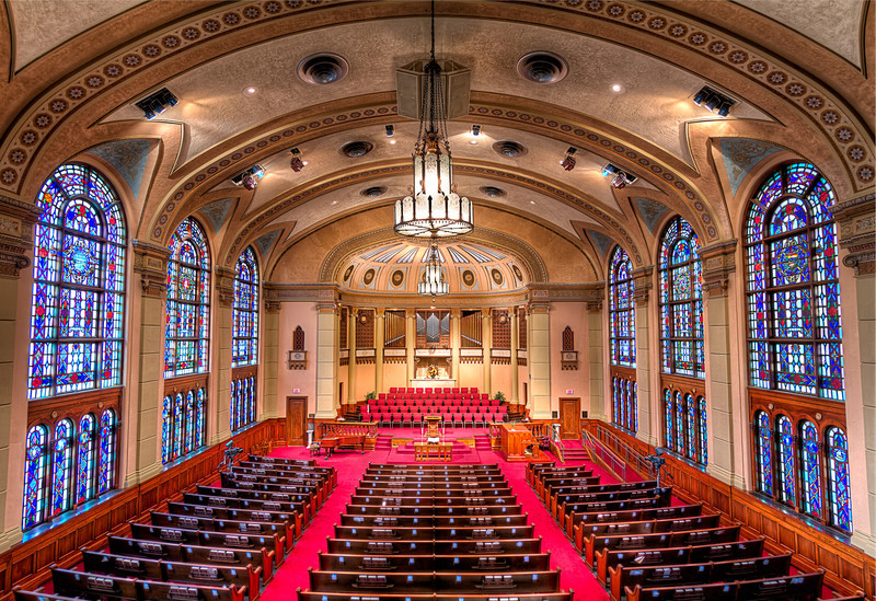 The South Main Baptist Church in Houston, looking from the balcony, looking forward towards the podium and choir loft. Photo by Tim Stanley Photography.