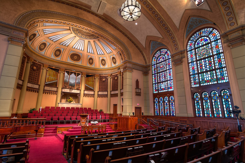 This view of South Main Baptist Church sanctuary is what you might see if you were in the congregation on Sunday morning, minus the people of course. The pipe organ and choir is an indication that worship could be more traditional than some newer contemporary churches.  Photo by Tim Stanley Photography.