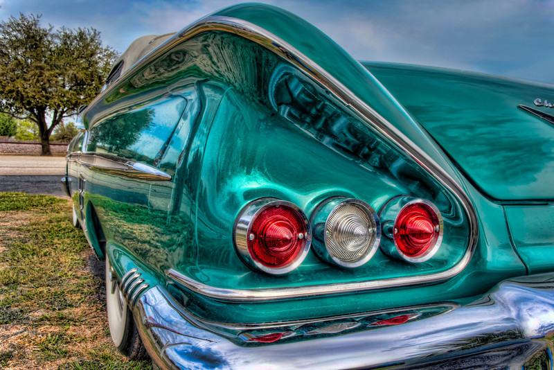 A cool thing about fifty's cars are the details, like big fins, chrome bumpers and bullet taillights. This Impala convertible is a great example of that styling. Photo by Tim Stanley Photography.
