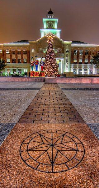 A large Christmas tree stands in front of City Hall in Sugar Land, Texas.