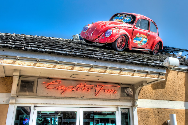 Sometimes you see something out of context and you have to blink and look again to see if you saw what you think you saw. Imagine the first time I saw a Volkswagon sitting atop a roof. Such is the case on this island shopping area in Pensacola.  Photo by Tim Stanley Photography.