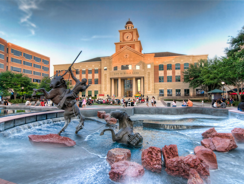 The Sugar Land Town Square is a pretty place at Christmas, so I know I'll return then, but Friday evening in August has a feel all it's own for photographers. Photo by Tim Stanley Photography.