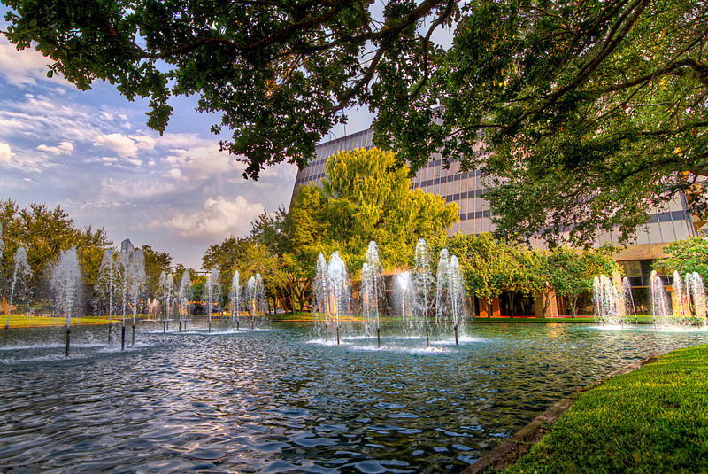 Sugar Creek on the Lake is a complex with fountains, a stream and huge trees and lots ofgreenery. There's even a large lake out back. It sure beats looking out on concrete and bricks all day long. Photo by Tim Stanley Photography.