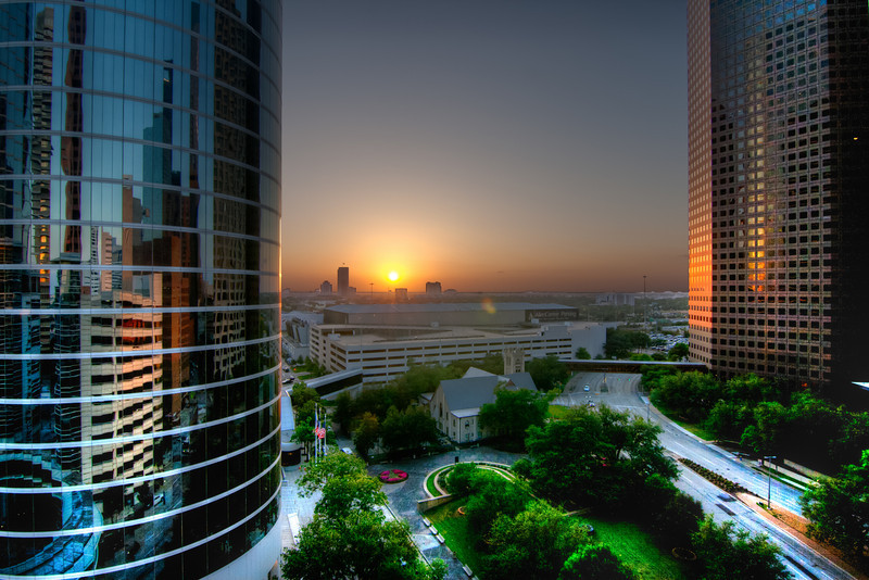 Downtown buildings make good subjects for backdrops in sunsets. My very first photo walk in downtown Houston started with a stop at the top of a parking garage at just the right time. Photo by Tim Stanley Photography