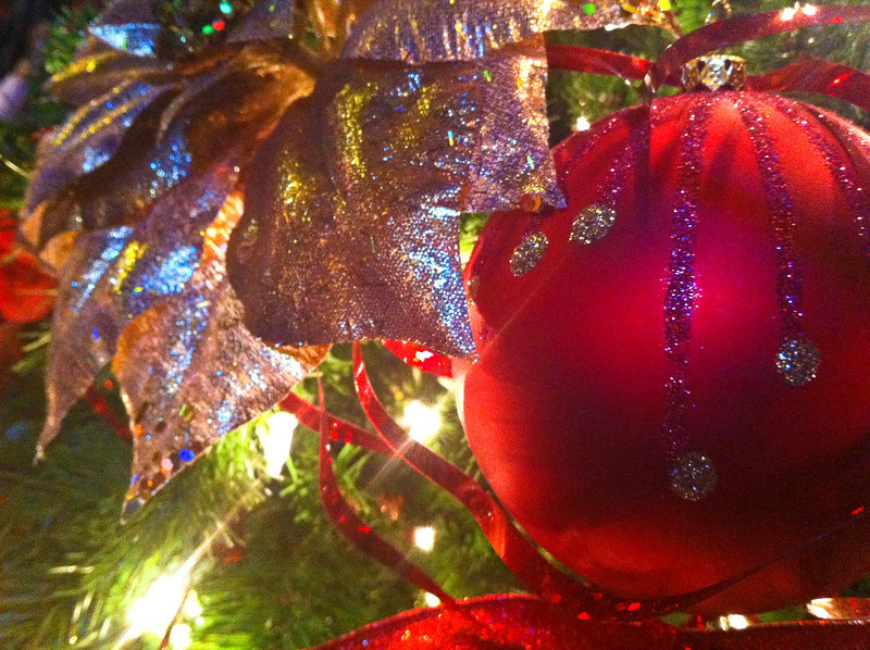 We were waiting for a table last night at a restaurant and were standing by their Christmas tree. Having just my iPhone, I thought I might chance a few photos. I'm sure a few folks thought I was silly for shooting an ornament, but I thought it turned out okay. Holiday Glitter