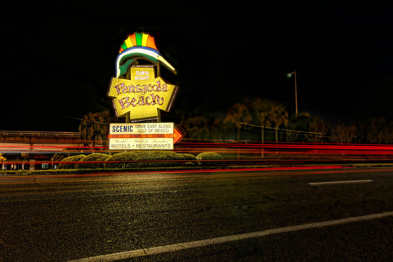 Anyone that has ever visited Pensacola Beach in Florida has driven right by this sign. During the day, it's easy to miss, since the